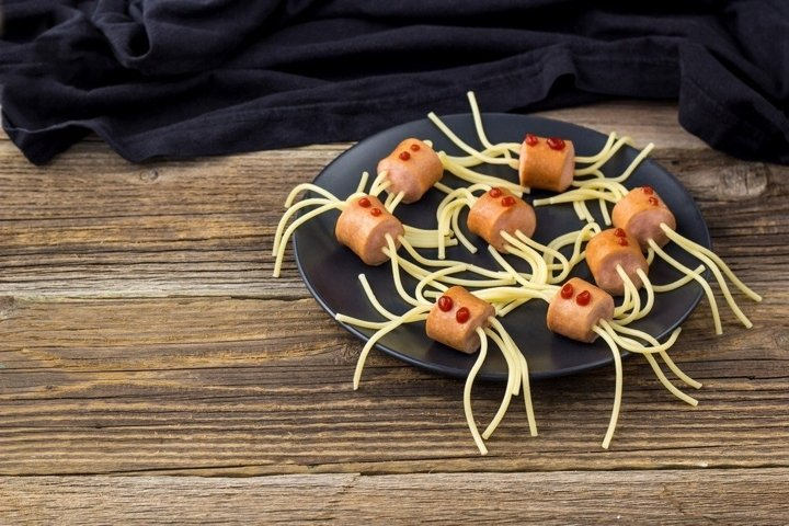 spaghetti with sausages in the form of spiders.
