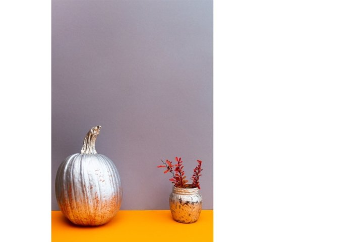 Still life of pumpkin painted with silver and gold paint