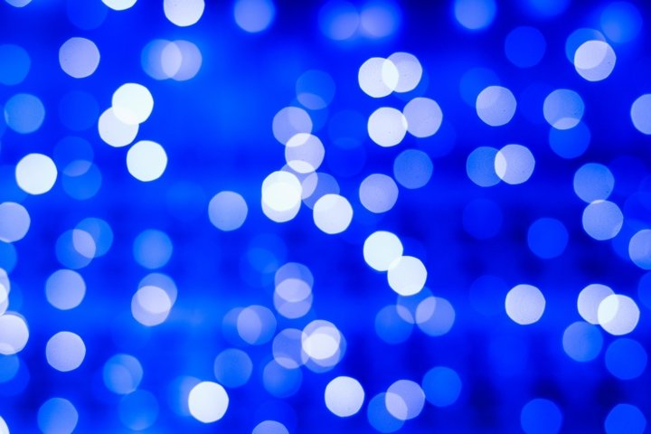 Defocused abstract blue bokeh lights background