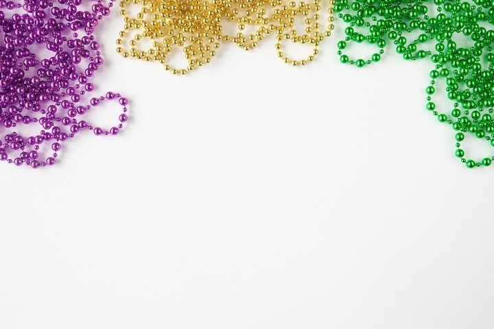 Mardi gras background, purple, green, and gold beads