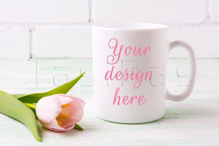 White coffee mug mockup with tender pink tulip flower.