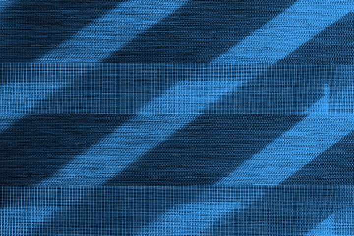 A fragment of blue window blinds on a Sunny day.