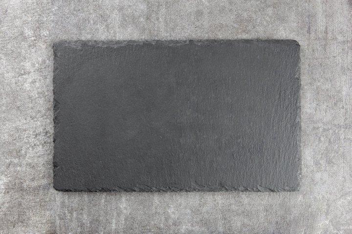 Black slate stone, concrete board. Dark background. Mockup.