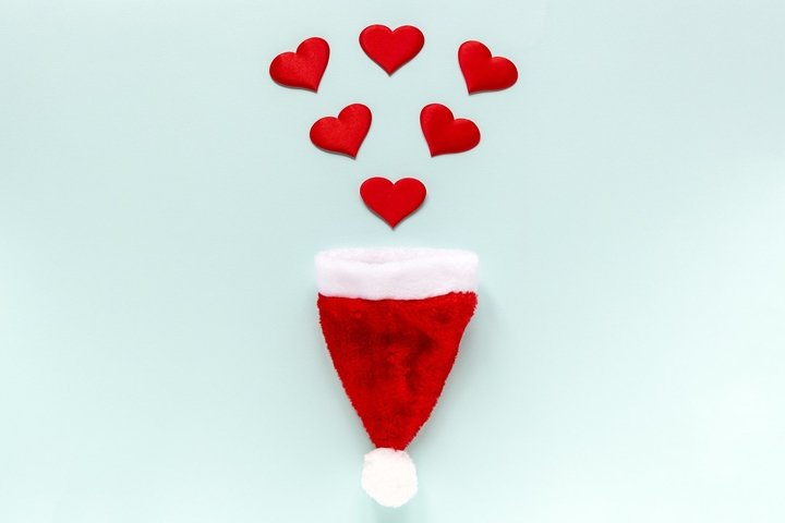 Red hearts falling into santa hat