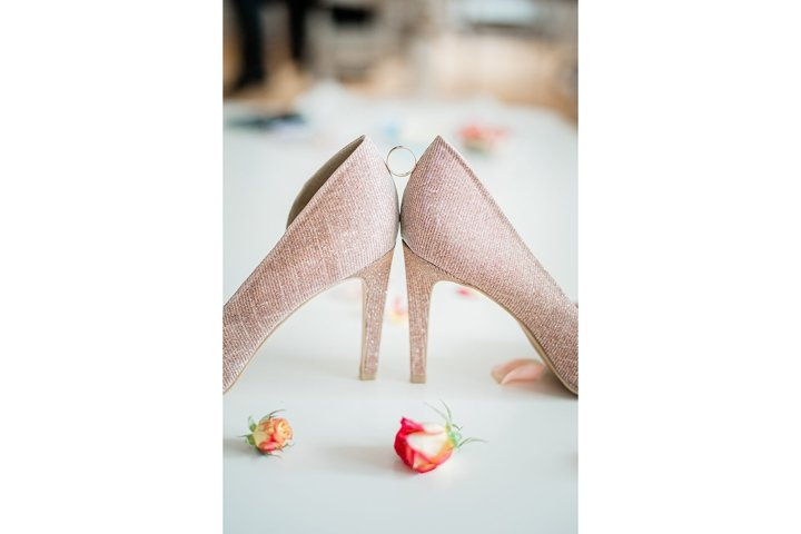 wedding ring between shoes