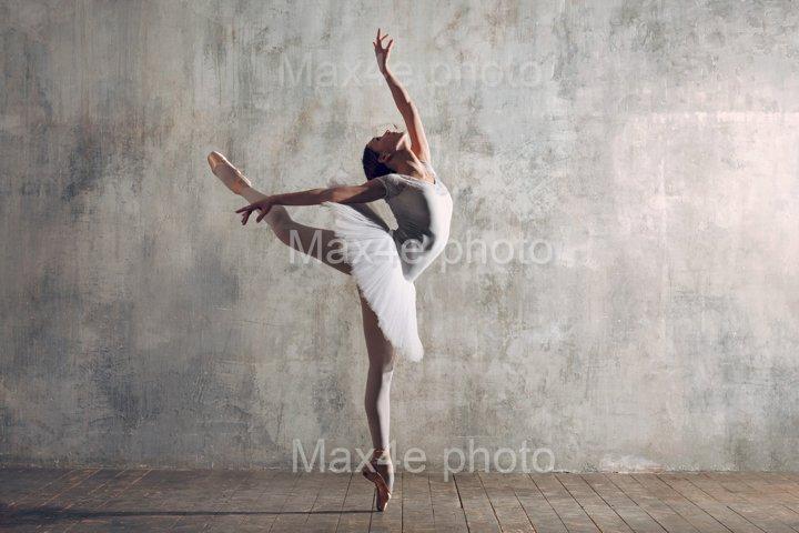 Ballerina pas in ballroom. Classical ballet dancing.