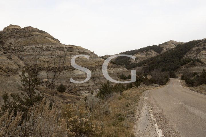 Mountain road through the badlands of Theodore Roosevelt Nat