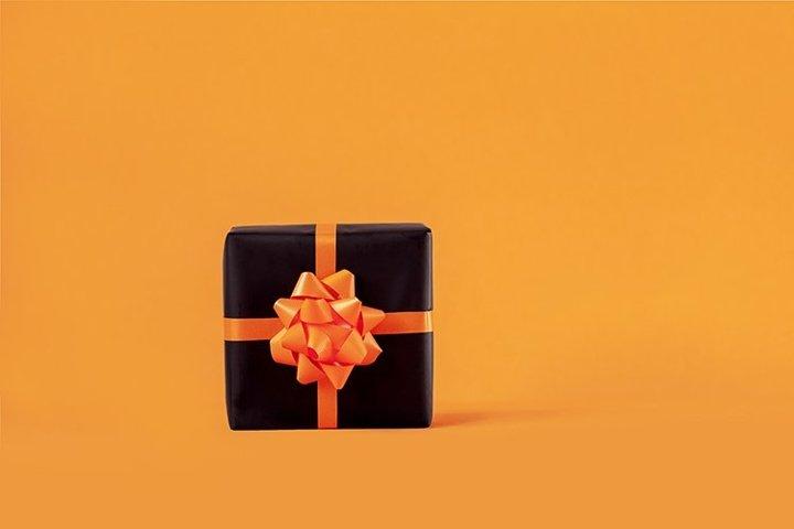 Black present box on orange background.