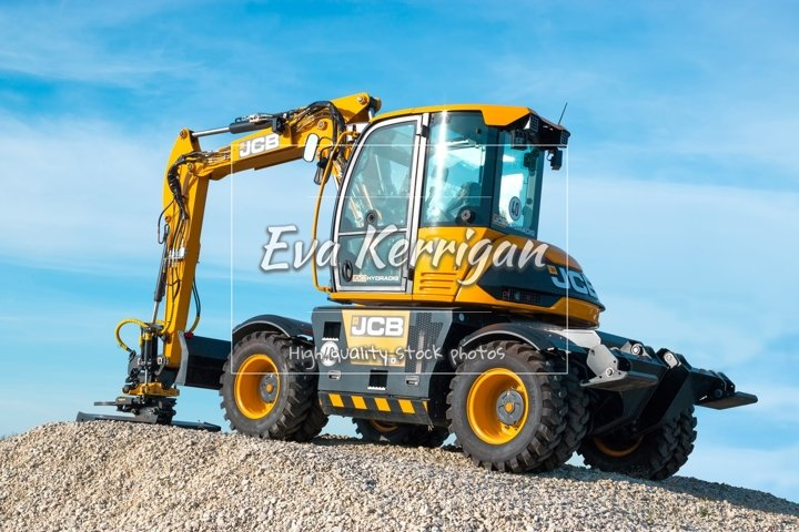 The JCB wheeled backhoe stands on the advertising stand.