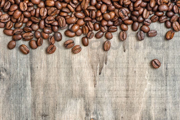 Coffee beans on rustic wooden background