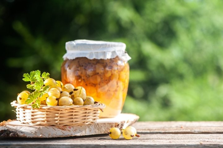 Gooseberry and jars of berry jam