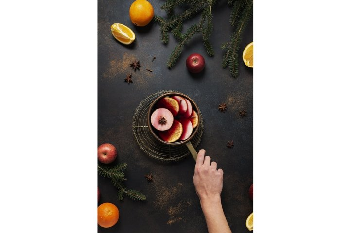 Winter mulled wine with orange, apple, cinnamon and anise