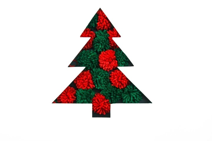 Cut paper in fir-tree shape for christmas card or new year