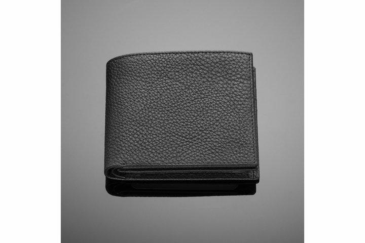 Fashionable designer leather mens wallet on a black