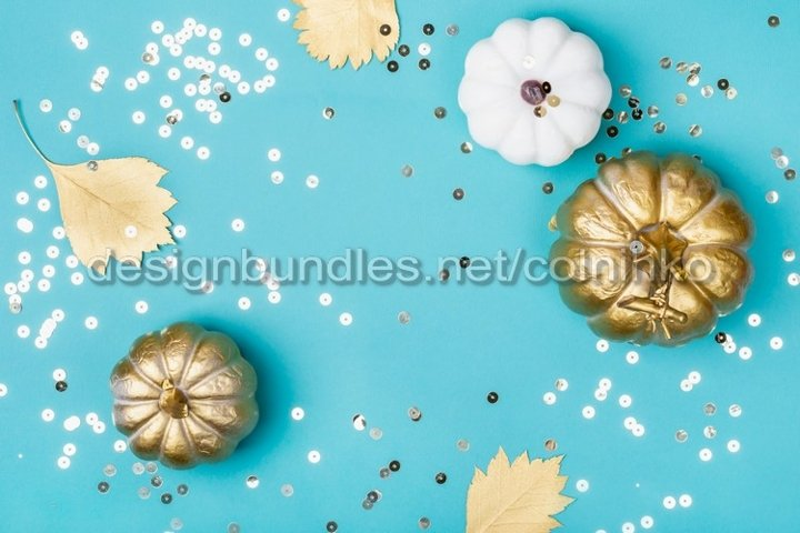 Golden decorative pumpkins and sparkles frame