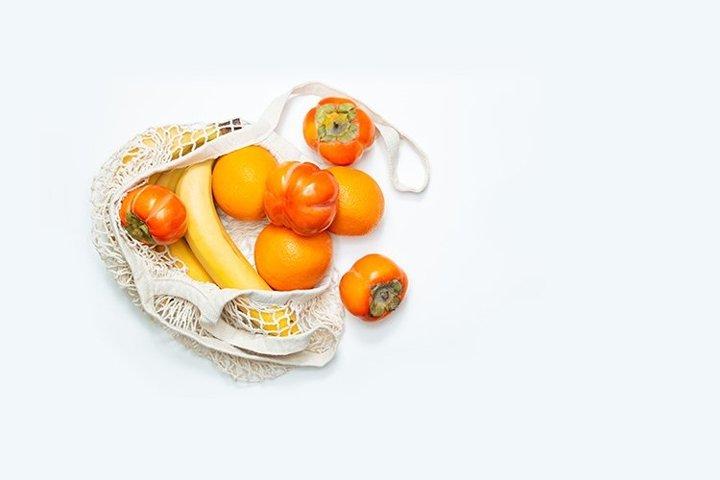 Fruit in a mesh shopping bag.