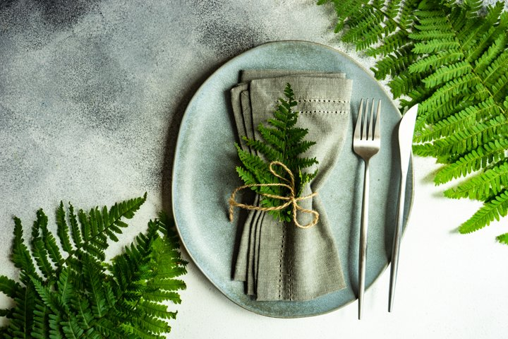 Summer rural table setting with fern