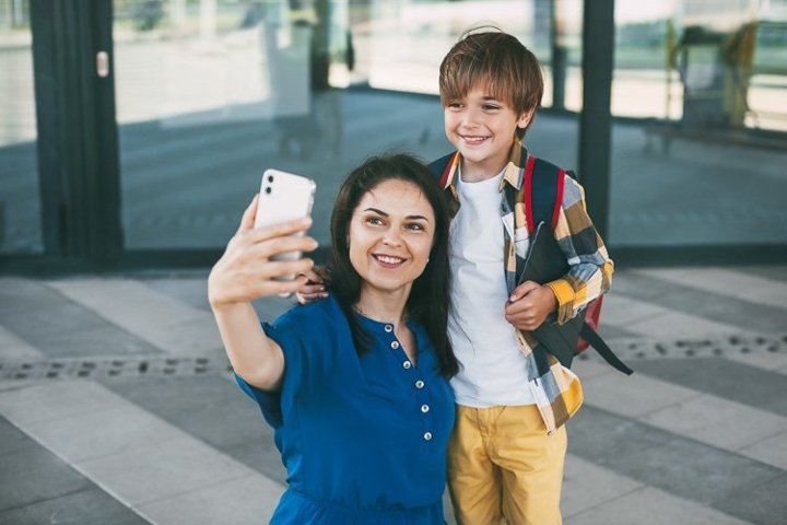 Mom and child take a selfie before going to school
