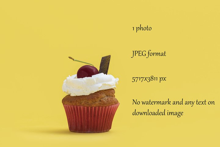 Festive colorful yellow background with delicious cupcake