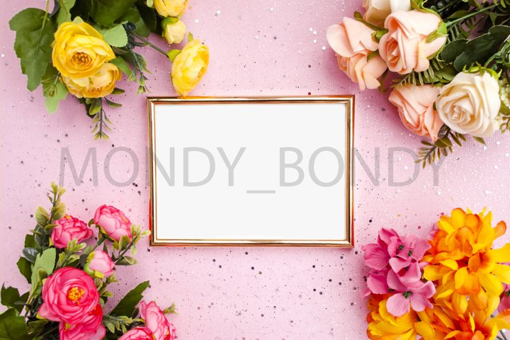 Gold frame for photography, flowers, pink background with sp