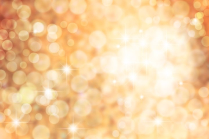 Golden Christmas defocused lights. Abstract background