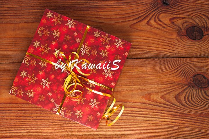 New year Christmas red gift box golden bow wooden background