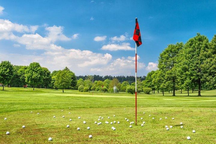 Golf course red flag green golf field. Golf club