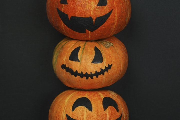 Halloween pumpkins with smile and paper bats