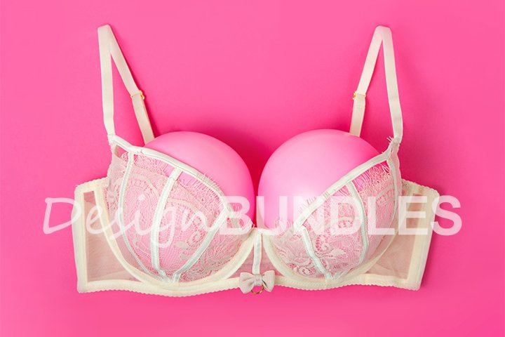 Bra with pink balloons on a pink background. Fun, conceptual