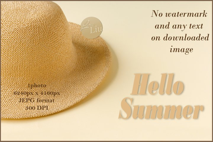 Beautiful straw hat on the ocean coast. Summer background.