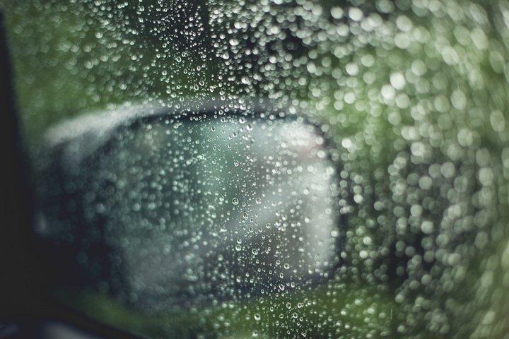 Raindrops on the cars glass window