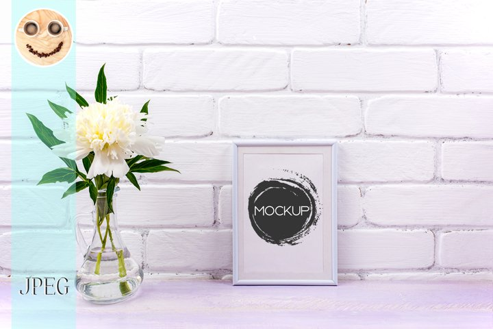White small frame mockup with peony in glass pitcher