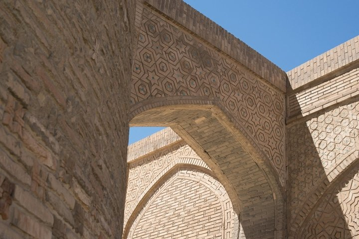 Old building with arch. Ancient architecture of Central Asia