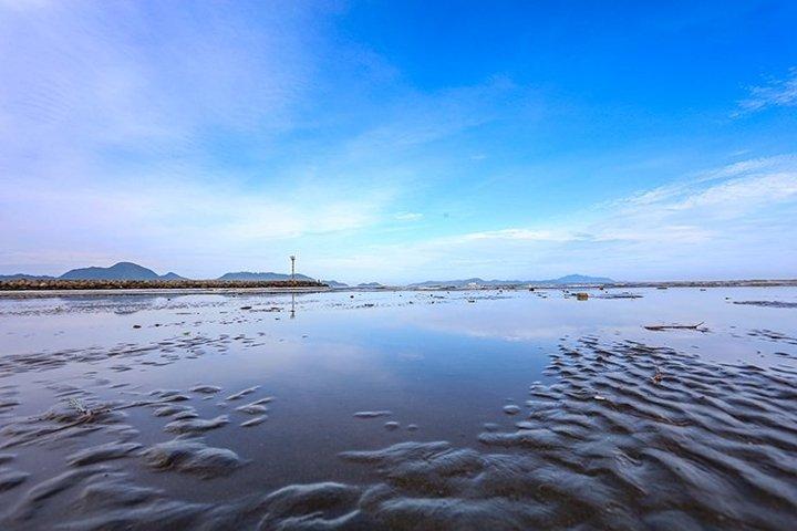 Blue Sky on the beach reflection