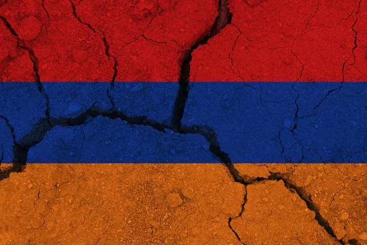 Armenia flag on the cracked earth. National flag of Armenia.