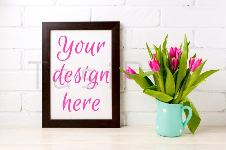 Black brown frame mockup with bright pink tulips bouquet