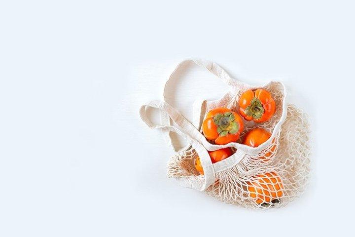 Persimmon in a mesh bag.