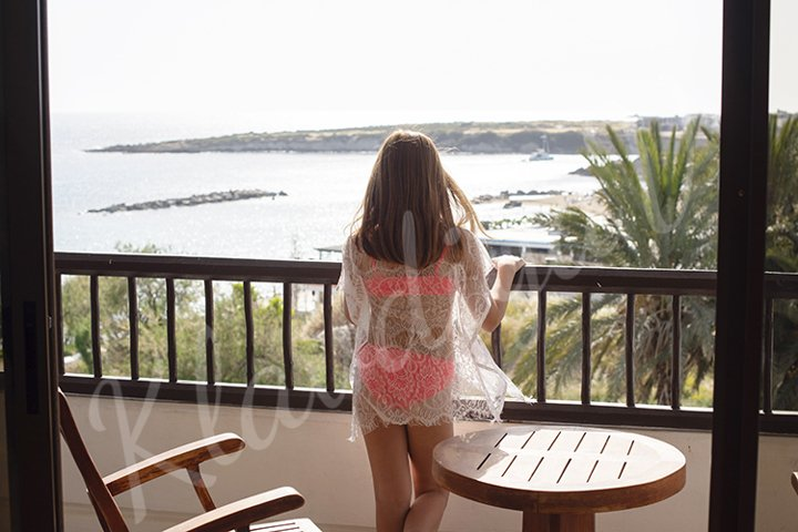 teenage girl in a swimsuit on the balcony