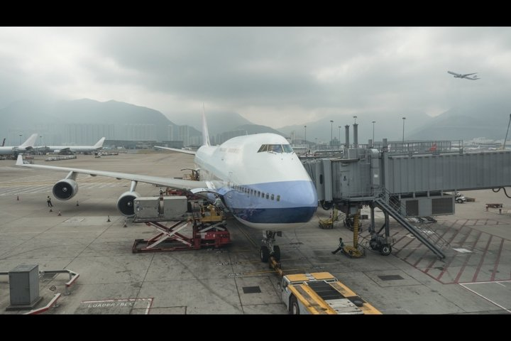Loading cargo into the plane, Hong Kong