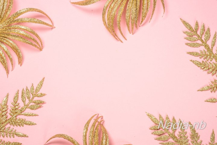 Gold leaves on pink background