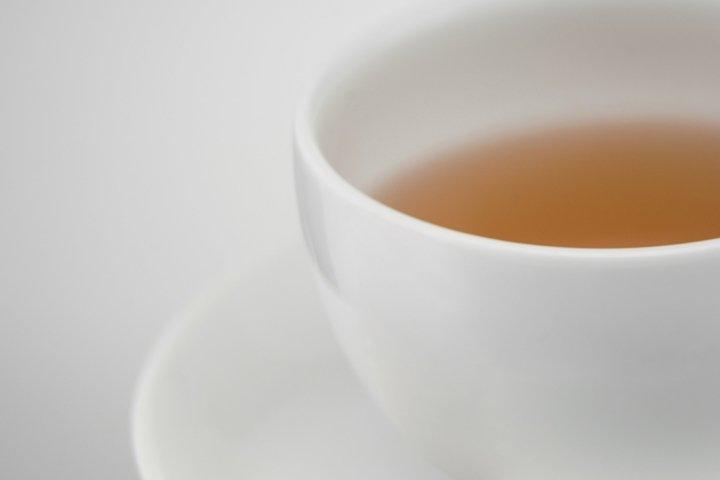 White ceramic cup of tea, close-up