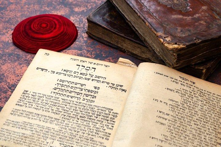 Jewish Bible. Stack of old leather-bound Jewish books