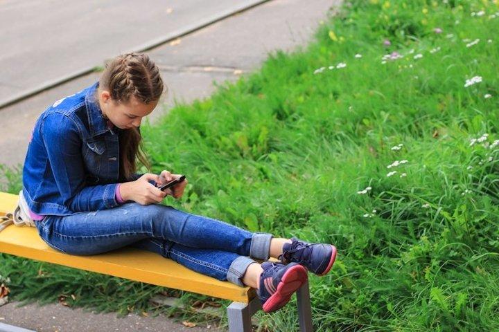 Caucasian school teenager girl with smart phone