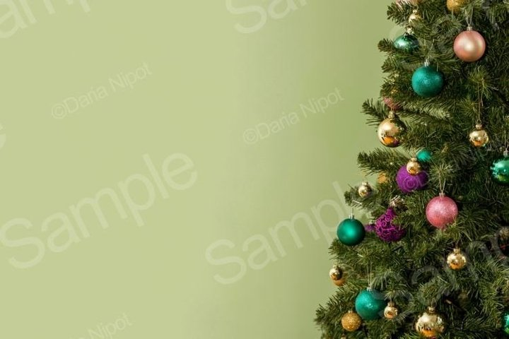 Christmas tree on green background with copy space
