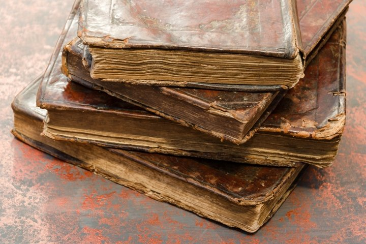 Stack of old and worn leather cover books
