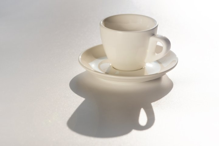 Empty clean white coffee cup on white background