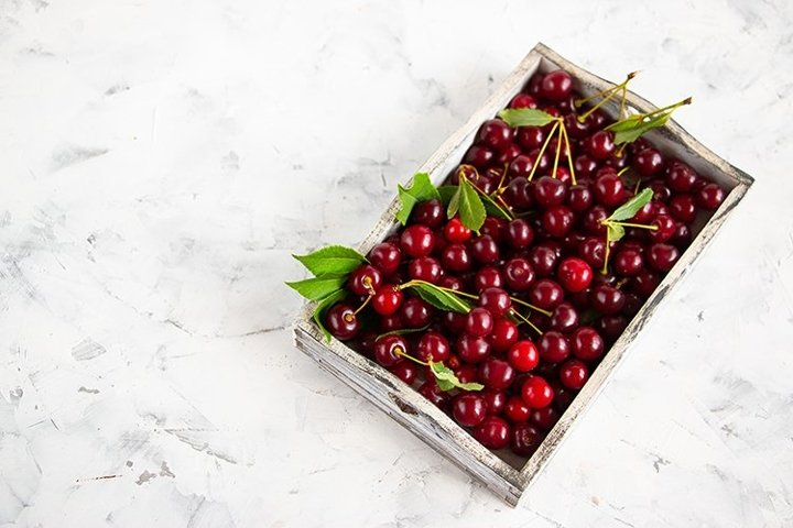 Cherries on a light concrete background.