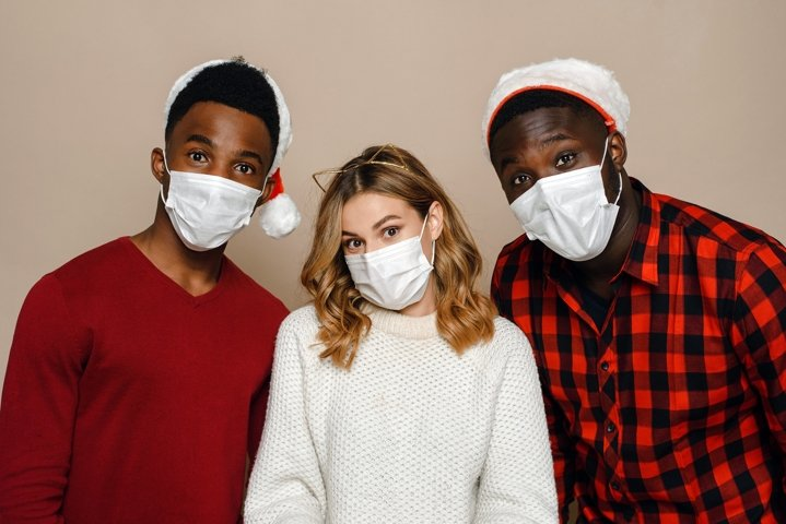 Two black guys and a Caucasian young woman in medical masks