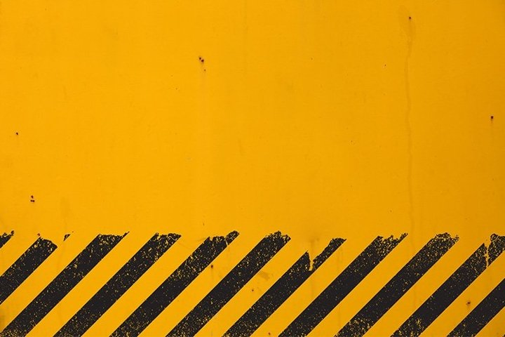 Yellow Background with Black Grunge Hazard Sign