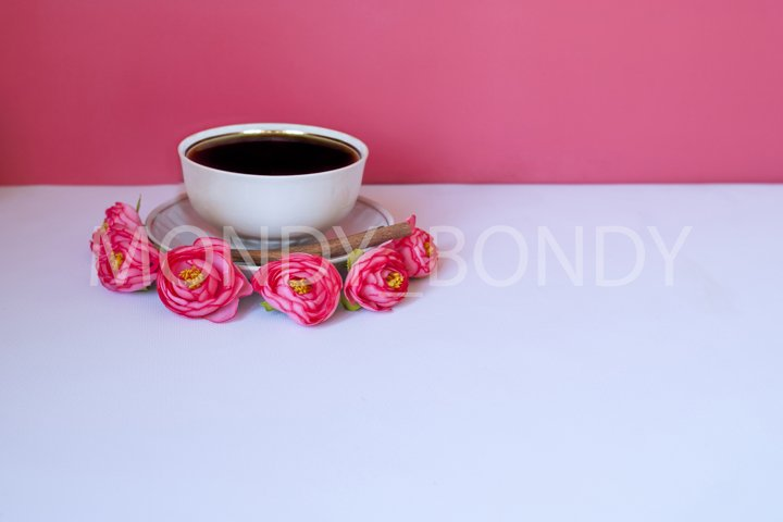 Cup of coffee with cinnamon on a white background